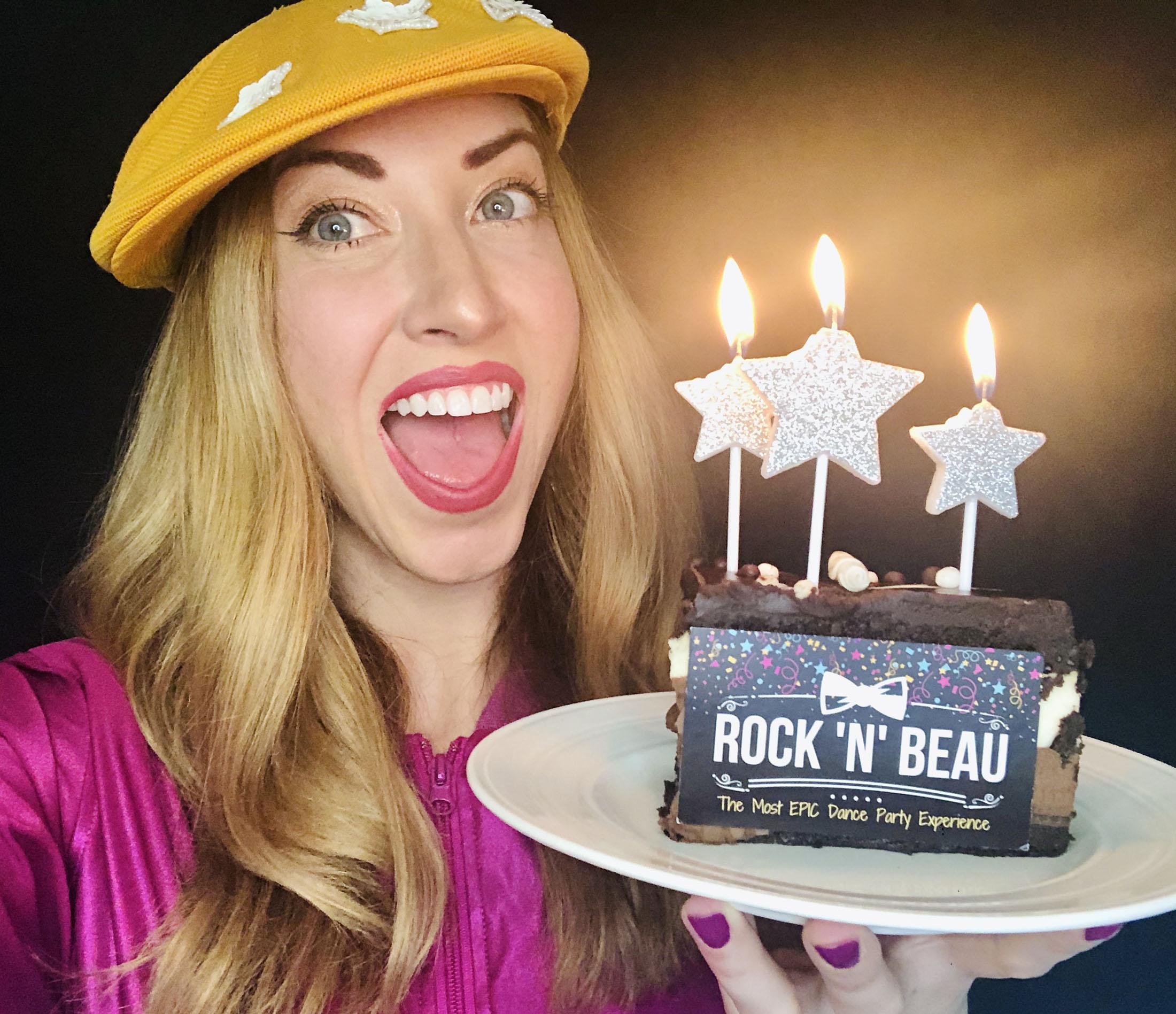 Rachel holding cake